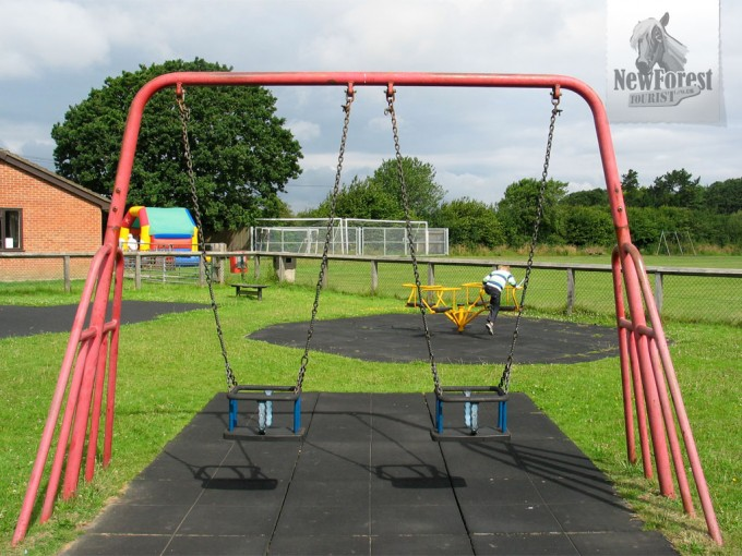 Toddler swings (larger swings are on the edge of the field)