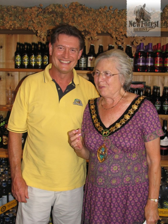 Mark Allen with Councillor Christine Ford as she strikes a pint-holding pose.